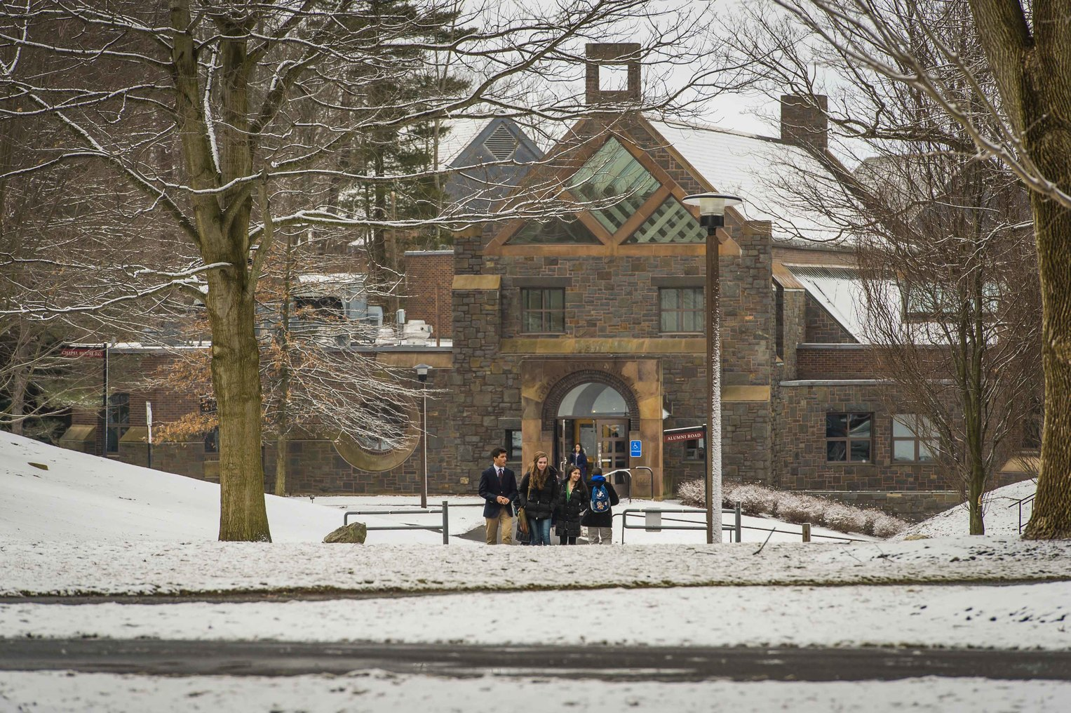 Curtiss E. Frank Dining Hall outside view with snow on trees